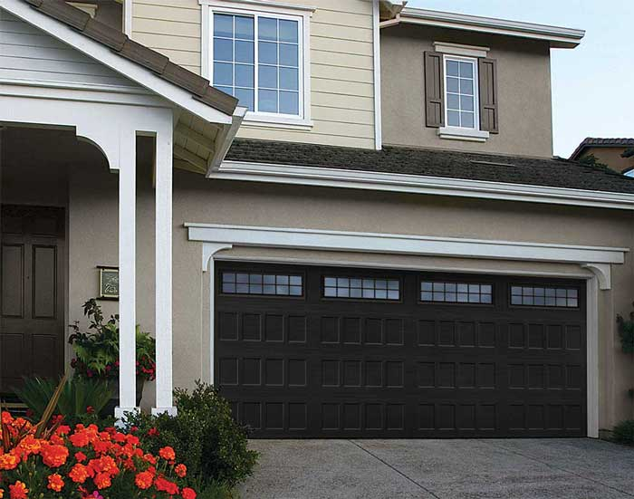 House with new dark colored garage